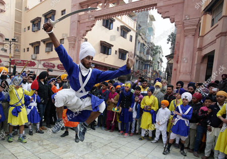Stock Picture of A Sikh man exhibits his skills with a sword as he performs Gatka, a form of Sikh martial art during a religious procession on the eve of the 350th birth anniversary of the tenth Guru or master of the Sikhs, Sri Guru Gobind Singh in Amritsar, India, 04 January 2016. Guru Gobind Singh Ji was the tenth Sikh Guru who initiated the special order or sect of the Sikhs called the Khalsa Panth.