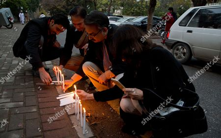 People light candles at the site where Salman Taseer, the governor of Pakistan's Punjab province, was killed, in Islamabad, Pakistan, . Taseer was killed in 2011 by his bodyguard who was reportedly enraged by Taseer's opposition to laws decreeing death for insulting Islam
