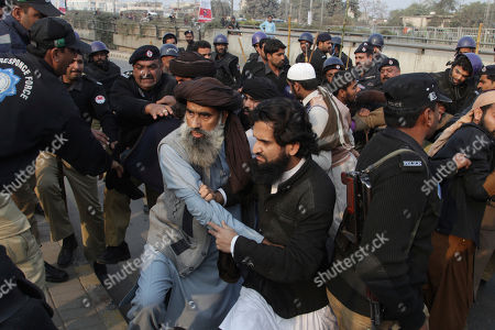 Police arrest supporters of a Pakistani religious group trying to rally in support of blasphemy laws, on the anniversary of the death of Salman Taseer, Pakistani governor of Pakistan's Punjab province, who was killed by his bodyguard in 2011 for opposing the country's harsh blasphemy laws, in Lahore, Pakistan