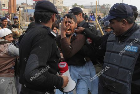 Stock Photo of Police arrest supporters of a Pakistani religious group trying to rally in support of blasphemy laws, on the anniversary of the death of Salman Taseer, Pakistani governor of Pakistan's Punjab province, who was killed by his bodyguard in 2011 for opposing the country's harsh blasphemy laws, in Lahore, Pakistan