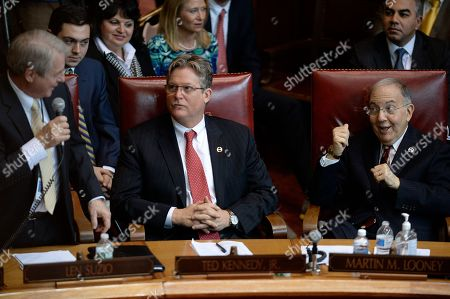 Stock Photo of Len Suzio, Martin Looney, Ted Kennedy Jr State Sen. Len Suzio, R- Meriden, left, talks to Senate President Pro Tempore Martin M. Looney, D-New Haven, right, as Sen. Ted Kennedy Jr., D-Branford, center, looks, during opening session at the state Capitol, in Hartford, Conn