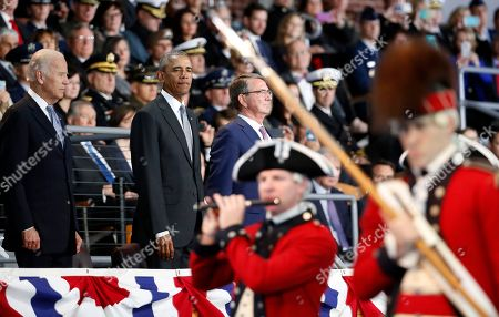"""Barack Obama, Joe Biden, Ashton Carter President Barack Obama, with Vice President Joe Biden and Defense Secretary Ashton Carter, watches the Old Guard Fife and Drum Corps perform a """"Troops In Review,"""" during an Armed Forces Full Honor Farewell Review for the president, at Conmy Hall, Joint Base Myer-Henderson Hall, Va"""