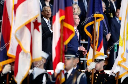 Barack Obama, Ashton Carter President Barack Obama, left, and Defense Secretary Ashton Carter, are seen between flags during an Armed Forces Full Honor Farewell Review for the president, at Conmy Hall, Joint Base Myer-Henderson Hall, Va