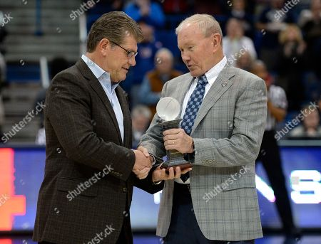 Geno Auriemma, Martin E. Dempsey Connecticut head coach Geno Auriemma is presented with the USA Basketball coach of the year award by USA Basketball chairman, retired Gen. Martin E. Dempsey, before an NCAA college basketball game against East Carolina, in Hartford, Conn