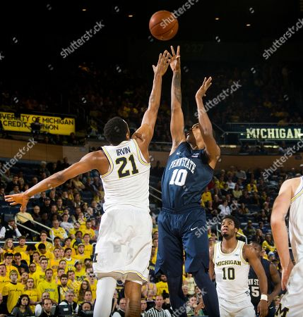 Zak Irvin, Tony Carr Michigan guard Zak Irvin (21) defends a shot attempt from Penn State guard Tony Carr (10) in the first half of an NCAA college basketball game at Crisler Center in Ann Arbor, Mich