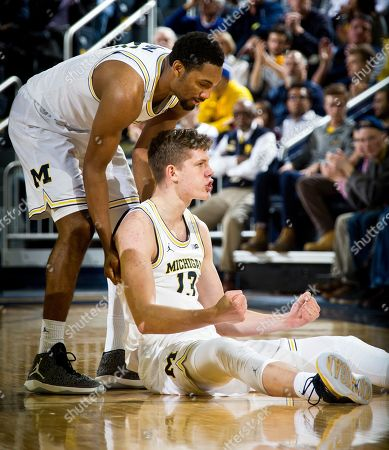 Zak Irvin, Moritz Wagner Michigan guard Zak Irvin (21) celebrates with forward Moritz Wagner (13), of Germany, in the second half of an NCAA college basketball game against Penn State at Crisler Center in Ann Arbor, Mich., . Michigan won 72-69