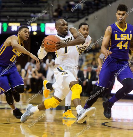 Stock Photo of Jalyn Patterson, Wayde Sims, Terrence Phillips Missouri's Terrence Phillips, center, drives between LSU's Jalyn Patterson, left, and Wayde Sims, right, during the first half of an NCAA college basketball game, in Columbia, Mo. LSU won the game 88-77