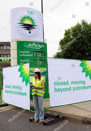 A Greenpeace Activist Mans a British Petroleum Petrol Station Closed Due to the Greenpeace Protest in Camden London 27 July 2010 Greenpeace Activists Say They Have Shut Down Every Bp Petrol Station in London Putting Up Signs Saying: 'Closed Moving Beyond Petroleum' Bp Has Confirmed Tony Hayward Will Step Down After the Company Posted Losses of ú11bn For the Second Quarter of the Year United Kingdom London