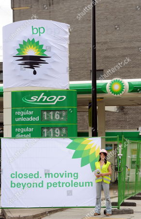 Stock Picture of A Greenpeace Activist is Pictured in a Bp Petrol Station Closed Due to the Greenpeace Protest in Camden London Britain 27 July 2010 Greenpeace Activists Say They Have Shut Down Every Bp Petrol Station in London Putting Up Signs Saying: 'Closed Moving Beyond Petroleum' Bp Has Confirmed Tony Hayward Will Step Down After the Company Posted Losses of ú11bn For the Second Quarter of the Year United Kingdom London