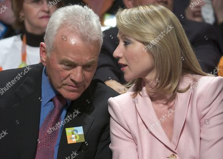 Torcan04 20040320 Toronto Canada: (r) Belinda Stronach Former President and Ceo of Magna International Talks with Her Father Frank While the Votes Are Counted in the Conservative Party of Canada's Leadership Race in Toronto Canada on March 20 2004 Belinda Stronach One of Three Candidates Lost Her Bid to Become Party Leader Losing to Stephen Harper in January 2004 Belinda Stronach Stepped Down From Magna International to Enter Canadian Federal Politics Belinda Stronach Will Run For a Seat in Parliament in the Next Federal Election Later This Year Epa Photo - Warren Toda Canada Toronto