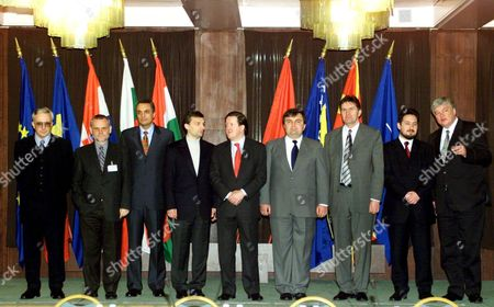 Stock Picture of Budapest Hungary: Participants of the Prime Ministerial Summit of the Countries Bordering Yugoslavia Stand Together For a Family Picture in Thermal Hotel in Budapest on Friday 17 March 2000 (l-r) Pms Mugur Isarescu of Romania Ivica Racan of Croatia Ivan Kostov of Bulgaria Viktor Orban of Hungary Nato Secretary General George Robertson Ilir Meta of Albania President of Bosnia-herzegovina Ejup Ganic Lubcho Georgievski of Macedonia and Eu Special Coordinator For the South-eastern European Stability Pact Bodo Hombach