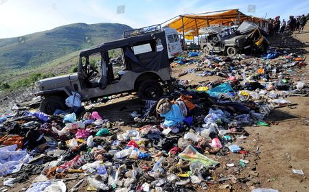 Overturned Vehicles and Belongings of Pilgrims at the Site of a Pilgrimage Stampede About 50 Miles (80 Kilometres) Northeast From the Famed Hindu Shrine of Sabarimala in the Southern Indian State of Kerala on 15 January 2011 at Least 104 People Died in a Stampede During a Pilgrimage to the Hindu Shrine of Sabarimala in the Southern Indian State of Kerala Officials Said 15 January Pilgrims Were Returning From the Shrine Down a Hillside Late Friday when a Vehicle Lost Control and Crashed Into the Crowd Triggering the Stampede Kerala Home Secretary Jai Kumar Said the Accident Took Place in a Densely Forested Hilly Terrain on a Path Leading to the Shrine So Far 74 of the Victims Have Been Identified India Sabarimala