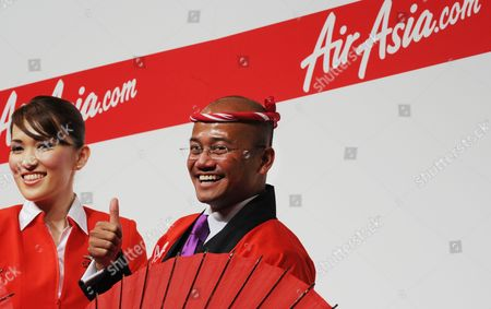 Azran Osman-rani (c) Chief Executive Officer of Airasia X Gestures During a Press Conference to Introduce the Low-cost Air Carrier's New Business Plans For Flights to Japan in Tokyo Japan 10 December 2010 the Low-cost Long-haul Airline Began Flights Between Asia and Japan on 09 December 2010 Japan Tokyo