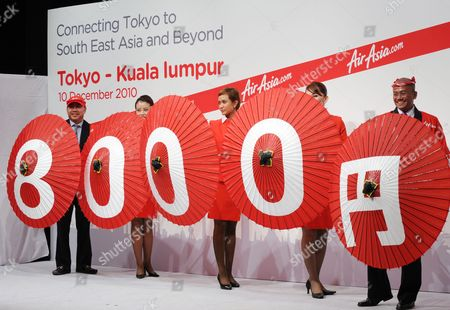 Airasia X Introduces Its 8 000 Yen (95 Us Dollars) Low-cost Air Fare Between Kuala Lumpur Malaysia and Tokyo During a Press Conference in Tokyo Japan 10 December 2010 the Low-cost Long-haul Airline Began Flights Between Asia and Japan on 09 December 2010 Or Far Right is Azran Osman-rani Chief Executive Officer of Airasia X Japan Tokyo