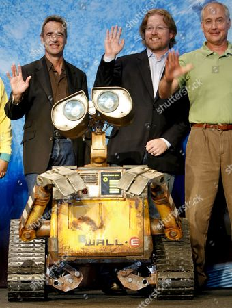 Us Director and Director of the Movie 'Wall-e' Andrew Stanton (c) Producer Jim Morris (l) and Sound & Character Voice Designer Ben Burtt (r) Wave on the Stage During a Press Conference Held in Tokyo Japan 08 October 2008 to Promote the Film Wall-e is a Computer-animated Science Fiction Film That Tells a Story About Wall-e a Robot Designed to Clean Up a Polluted Earth and His Love and Adventure with Another Robot Eve the Movie Will Hit the Cinemas All Over Japan on 05 December 2008 Japan Tokyo