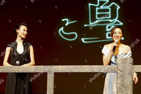 Malaysian Actress and Cast Member of the Us Film 'The Mummy: Tomb of the Dragon Emperor' Michelle Yeoh (r) Speaks As Chinese Actress and Cast Member Isabella Leong (l) Looks on During the Japan Premiere in Tokyo 04 August 2008 Directed by Us Director Rob Cohen the Third in a Series of Box Office Hits the Movie Tells the Story of Adventurer Rick O'connell (fraser) who Combats the Resurrected Han Emperor (jet Li) in an Epic That Races From the Catacombs of Ancient China High Into the Frigid Himalayas the Movie Will Hit the Cinemas All Over Japan on 16 August 2008 Japan Tokyo