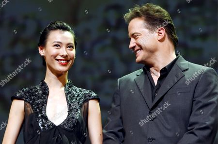 Chinese Actress and Cast Member of the Us Film 'The Mummy: Tomb of the Dragon Emperor' Isabella Leong (l) Smiles As Us Actor and Cast Member Brendan Fraser (r) Reacts on the Stage During a Promotional Event Held in Tokyo Japan 04 August 2008 Directed by Us Director Rob Cohen the Third in a Series of Box Office Hits the Latest Movie Tells the Story of Adventurer Rick O'connell (fraser) who Combats the Resurrected Han Emperor (jet Li) in an Epic That Races From the Catacombs of Ancient China High Into the Frigid Himalayas the Movie Will Hit the Cinemas All Over Japan on 16 August 2008 Japan Tokyo