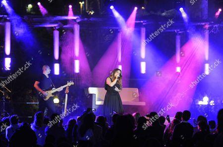 French Singer Helene Segara (r) Performs on Stage During a Concert at Edde Sand's Resort in Byblos (jbeil) North Beirut Lebanon 21 May 2010 Lebanon Byblos