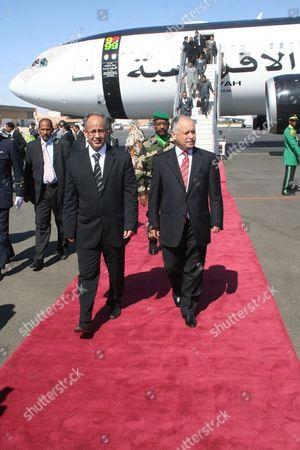 Stock Image of Mauritania's Premier Dr Moulaye Ould Mohamed Laghdaf (l) Welcomes El-baghdadi Ali El-mahmoudi Secretary General of the General Peoples Committee of the Libyan Arab Jamahiriya (r) at the International Airport in Nouakchott Mauritania on 18 February 2010 Mauritania Nouakchott