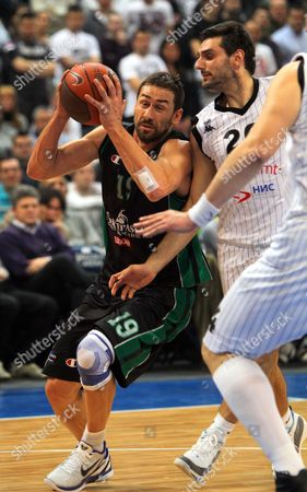 Marko Jaric (l) of Bc Montepaschi Siena in Action Against Petar Bozic of Bc Partizan Mt:s During Their Euroleague Top 16 Match in Belgrade Serbia 03 February 2011 Serbia and Montenegro Belgrade