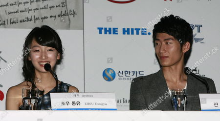 Chinese Actress Zhou Dongyu (l) and Actor Shawn Dou (r) Talk During a Press Conference to Present the Opening Film 'Under the Hawthorne Tree' of the 15th Pusan International Film Festival (piff) in Busan South Korea 07 October 2010 the Biggest Film Festival in Asia Showcases 308 Films From 67 Countries From 07 to 15 October in Busan Korea, Republic of Busan