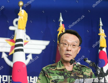 Stock Photo of South Korean Joint Chief of Staff Lee Hong Gi Confirms That Multiple Buildings on Yeonpyeong Island Were Destroyed by North Korean Shells at National Defense in Seoul Korea 23 November 2010 They Put Five Islands in the Area of the Attack on Highest Military Alert North Korea Fired More Than 200 Artillery Shells Into Yeonpyeong Island and the South Korean Navy Directly Returned Fire After 2:34 P M Today Two Fatalities a South Korean Marine was Confirmed by the Military and 16 Soldiers Were Wounded on the Island and Four Civilians Soldiers and Civilians Were Brought to Hospitals Korea, Republic of Seoul