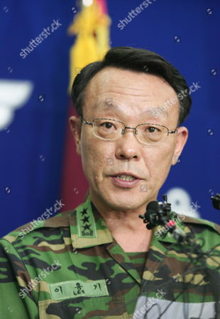 Stock Picture of South Korean Joint Chief of Staff Lee Hong Gi Confirms That Multiple Buildings on Yeonpyeong Island Were Destroyed by North Korean Shells at National Defense in Seoul Korea 23 November 2010 They Put Five Islands in the Area of the Attack on Highest Military Alert North Korea Fired More Than 200 Artillery Shells Into Yeonpyeong Island and the South Korean Navy Directly Returned Fire After 2:34 P M Today Two Fatalities a South Korean Marine was Confirmed by the Military and 16 Soldiers Were Wounded on the Island and Four Civilians Soldiers and Civilians Were Brought to Hospitals Korea, Republic of Seoul