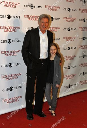 Us Actor Harrison Ford (l) and Us Actress Meredith Droeger (r) Arrive on the Red Carpet For the Premiere of the Movie 'Extraordinary Measures' in Chicago Illinois Usa 12 January 2010 the Movie Directed by Tom Vaughan Opens in the Us on 22 January United States Chicago