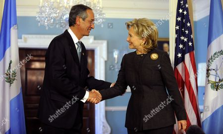 Us Secretary of State Hillary Clinton (r) Shakes Hands with Guatemala's President Alvaro Colom Caballeros Prior to Their Bilateral Meeting at the State Department in Washington D C Usa 18 February 2010 the Talks Were Expected to Center on Western Hemisphere Issues of Trade the Economic Crisis and Security United States Washington