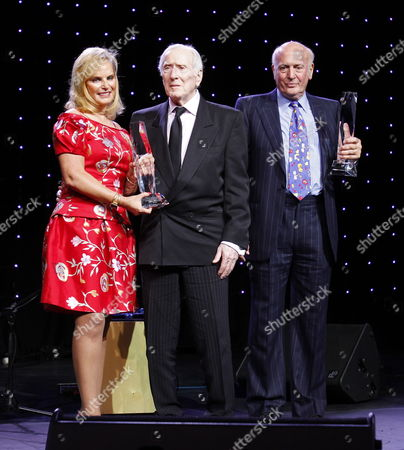 Narm Chairperson Rachelle Friedman (l) Poses with Us Song Writers and Music Producers Jerry Leiber (c) and Mike Stoller (r) who Received Outstanding Achievement Award For Musical Collaboration During the National Association of Recording Merchandisers (narm) Awards in Chicago Illinois Usa 17 May 2010 United States Chicago