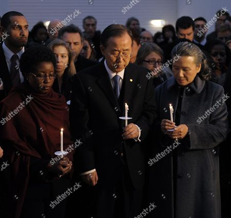 United Nations Secretary General Ban Ki-moon (c) Stands with His Wife Yoo Soon-taek (r) Deputy Secretary-general Asha-rose Migiro (l) and U N Staff Members During a Candle Light Vigil to Honor the United Nations Personnel Killed by Last Week's Earthquake in Haiti at United Nations Headquarters in New York New York Usa on 19 January 2010 United States New York