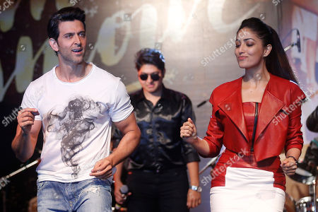 Bollywood actors Hrithik Roshan, left, and Yami Gautam perform during the song launch of their film Kaabil in Mumbai, India, . The film is scheduled for release on Jan. 25
