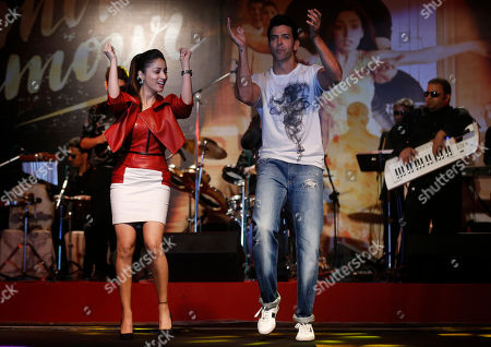 Bollywood actors Hrithik Roshan, right, and Yami Gautam perform during the song launch of their film Kaabil in Mumbai, India, . The film is scheduled for release on Jan. 25