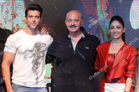 Bollywood actors Hrithik Roshan, left, along with Yami Gautam, right, and film producer Rakesh Roshan pose for photographs during the song launch of their film Kaabil in Mumbai, India, . The film is scheduled for release on Jan. 25