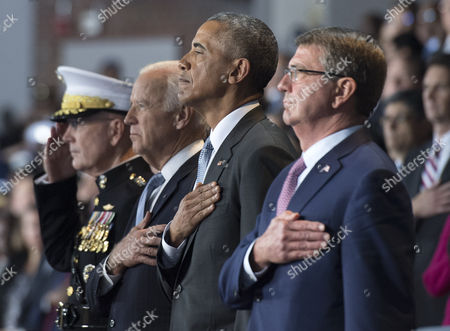 Stock Picture of United States President Barack Obama (2nd-R), Vice President Joe Biden (2nd-L) Chairman of the Joint Chiefs of Staff Gen. Joseph Dunford Jr. (L) and Secretary of Defense Ashton Carter stand for the National Anthem during President Obama's Armed Forces Full Honor Review Farewell Ceremony at Joint Base Myers-Henderson Hall, in Virginia