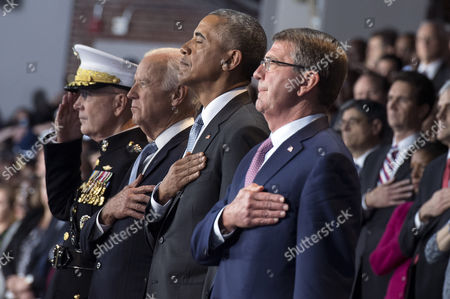 United States President Barack Obama (2nd-R), Vice President Joe Biden (2nd-L) Chairman of the Joint Chiefs of Staff Gen. Joseph Dunford Jr. (L) and Secretary of Defense Ashton Carter stand for the National Anthem during President Obama's Armed Forces Full Honor Review Farewell Ceremony at Joint Base Myers-Henderson Hall, in Virginia