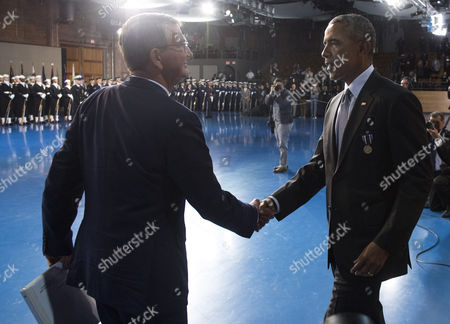United States President Barack Obama shakes hands with Secretary of Defense Ashton Carter during President Obama's Armed Forces Full Honor Review Farewell Ceremony at Joint Base Myers-Henderson Hall, in Virginia