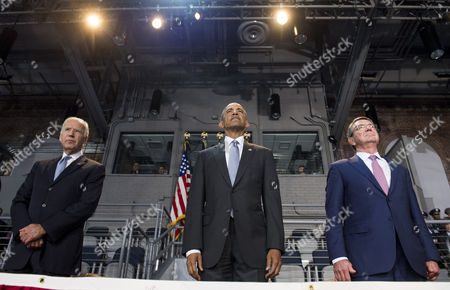 United States President Barack Obama (C), Vice President Joe Biden (L) and Secretary of Defense Ashton Carter stand during President Obama's Armed Forces Full Honor Review Farewell Ceremony at Joint Base Myers-Henderson Hall, in Virginia