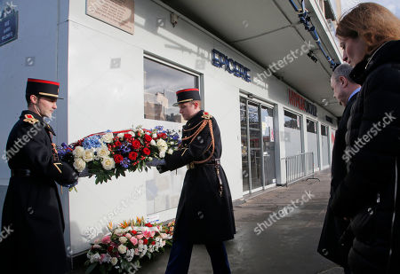 French Interior Minister Bruno Leroux, left, and State Secretary in charge of Victims Juliette Meadel, right, attend a ceremony at the place of the terrorist attack at the kosher supermarket to mark the second anniversary of the attacks