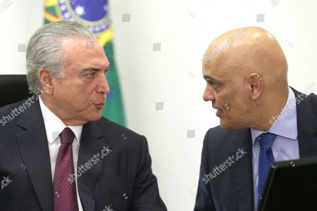 Michel Temer, Alexandre de Moraes Brazil's President Michel Temer, left, speaks with Justice Minister Alexandre de Moraes during a meeting with the Institutional Security Council of the Federal Government regarding the deadly prison riots with in Amazonas state, at the Planalto Presidential Palace, in Brasilia, . Brazil's bar association is suing the Amazonas state government, accusing him of negligence in regards to the riots and a judge has given Gov. Jose Melo 72 hours to respond to the accusation
