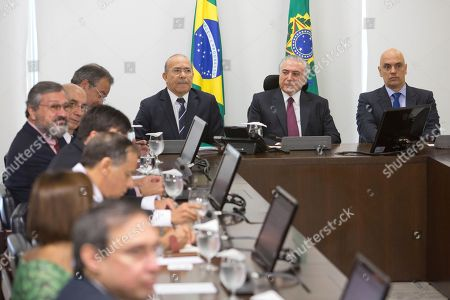 Michel Temer, Alexandre de Moraes, Eliseu Padilha Brazil's President Michel Temer, second right, his Chief of Staff Eliseu Padilha, third from right, and the Justice Minister Alexandre de Moraes, right, attend a meeting with the Institutional Security Council of the Federal Government regarding the deadly prison riots in Amazonas state, at the Planalto Presidential Palace, in Brasilia, . Brazil's bar association is suing the Amazonas state government, accusing him of negligence in regards to the riots and a judge has given Gov. Jose Melo 72 hours to respond to the accusation