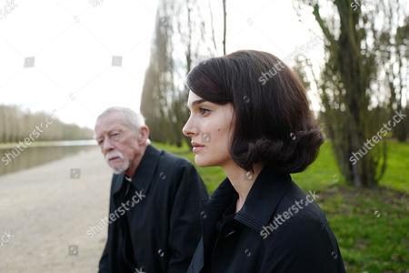 "John Hurt as ""The Priest"" and Natalie Portman as [Jackie Kennedy]"