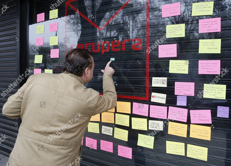 A man looks at the window of the new office that will be opened by PSOE critics in Ferraz street in Madrid, Spain, 500 meters away from PSOE's headquarters on 05 January 2017. Socialist critics of the party's actions planned to open a new office to promote the affiliation to the party next door to the PSOE's headquarters under the name 'Recover PSOE'. The party's management committee in charge of the socialist party since its leader Pedro Sanchez resigned, has requested to remove the word 'PSOE' from it's name claiming it was 'a seizure' of the party's name. Finally, critics have decided to remove 'PSOE' from the office name but have kept the motto 'affiliate, don't let anyone choose for you'.