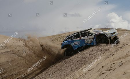 Romain Dumas, Alain Guehennec Driver Romain Dumas, of France, and co-driver Alain Guehennec, of France, race their Peugeot during the fourth stage of the Dakar Rally between San Salvador de Jujuy, Argentina and Tupiza, Bolivia, . The race started in Paraguay