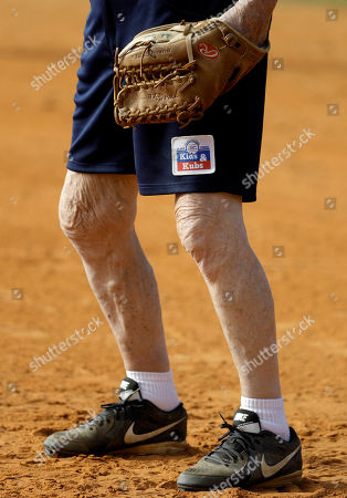 Kids & Kubs, Andy Devine 94-year-old Andy Devine waits for a play at first base a Kids & Kubs softball game in St. Petersburg, Fla. The Kids & Kubs is a Depression Era creation, beginning in the 1930's. All players in the league are over 75-years of age