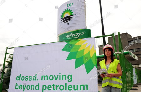 Stock Photo of A Greenpeace Activist is Pictured in a Bp Petrol Station Closed Due to a Protest in Camden London Britain 27 July 2010 Greenpeace Activists Say They Have Shut Down Every Bp Petrol Station in London Putting Up Signs Saying: 'Closed Moving Beyond Petroleum' Bp Has Confirmed Tony Hayward Will Step Down After the Company Posted Losses of ú11bn For the Second Quarter of the Year United Kingdom London