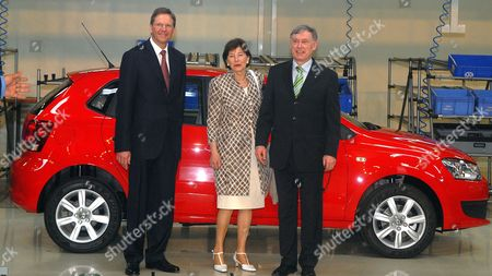 German First Lady Eva Luise (c) German President Horst Kohler (r) and Volkswagen Ag Member of the Board of Management Jochem Heizmann (l) Pose in Front of a Polo Car During Their Visit to the Volkswagen Factory in Pune India on 04 February 2010 After His Six-day State Visit in India Koehler Will Visit South Korea India Pune