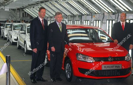 President and Managing Director of Volkswagen India Jorg Muller (r) German President Horst Kohler (c) and Volkswagen Ag Member of the Board of Management Jochem Heizmann (l) Pose in Front of a Polo Car During Their Visit to the Volkswagen Factory in Pune India on 04 February 2010 After His Six-day State Visit in India Koehler Will Visit South Korea India Pune