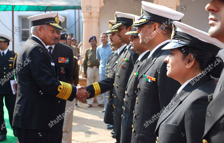 Indian Navy Chief Admiral Nirmal Verma (l) Shakes Hand with a Naval Officer During the Inauguration of a Naval Health Camp in Hoshangabad Madhya Pradesh India on 30 November 2010 Admiral Nirmal Verma Visited His Hometown Hoshangabad and Visited in the District Hospital For a Health Camp India Hoshangabad