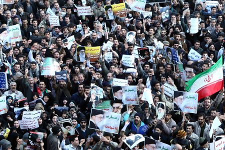 Thousands of Iranian Government Supporters Stage a Protest Against Opposition Leaders on 18 February 2011 in Tehran Iran More Than 200 Legislators Several Clerical Groups and Government Supporters Have Called For the Arrest and Execution of Mir-hossein Moussavi and Mehdi Karroubi Two Leaders of the Opposition Green Movement For Allegedly Undermining the Islamic System and Collaborating with Foreigners Thousands of Government Supporters Gathered After Friday Prayers in Enqelab Square in Central Tehran and Took Up the Call Shouting 'Moussavi and Karroubi Should Be Hanged ' Iran (islamic Republic Of) Tehran
